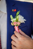 White rose boutonniere on suit of the groom Royalty Free Stock Photo