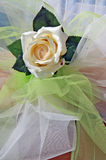 White rose and bows of tulle Stock Images