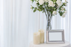 White rose with candle wedding beautiful photo frame. Love home decoration or wedding background Stock Photos