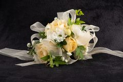 White Rose Corsage. Beautiful corsage wit white roses, baby's breath, and white ribbon royalty free stock image