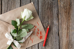 White rose on craft paper Stock Photos