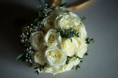 White rose flower bouquet in bundle shape for bridal in wedding. Ceremony Stock Photos
