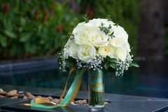 White rose flower bouquet in bundle shape for bridal in wedding. Ceremony put beside swimming pool Stock Photography