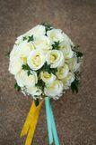 White rose flower bouquet in bundle shape for bridal in wedding. Ceremony Stock Photo