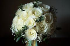 White rose flower bouquet in bundle shape for bridal in wedding. Ceremony Stock Images