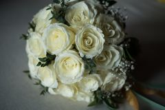 White rose flowers bouquet in bundle shape for bridal in wedding. White rose flower bouquet in bundle shape for bridal in wedding ceremony Royalty Free Stock Photo