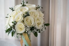 White rose flowers bouquet in bundle shape for bridal in wedding. White roses flower bouquet in bundle shape for bridal in wedding ceremony Royalty Free Stock Image