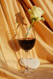 White rose in a glass of wine, love concept royalty free stock image