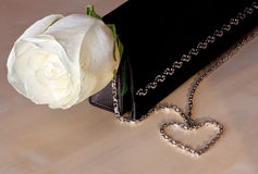 White rose and heart Stock Photos