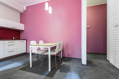 White and rose kitchen. In small house Stock Photography