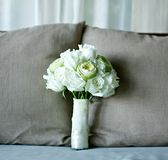 White rose and lotus flower wedding bouquet on bed Royalty Free Stock Photography