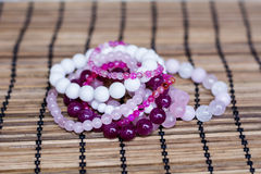 White and rose quartz crystal bracelets Stock Photo