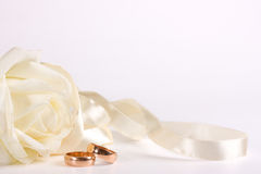 White rose, wedding ring and ribbon Royalty Free Stock Images