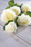 White roses. Bouquet of white roses on the table royalty free stock photo