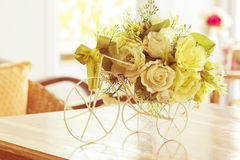 White roses in a bicycle vase. On vintage Royalty Free Stock Images