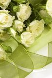 White roses bouquet. White roses with green tape on white background Stock Image