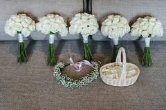 5 white roses Bouquet with Flower crown and the basket of rose petals royalty free stock images