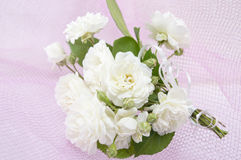 White roses bouquet on romantic pink background Royalty Free Stock Photo