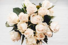 White roses bouquet on white wooden background isolated. Top vie Stock Photo