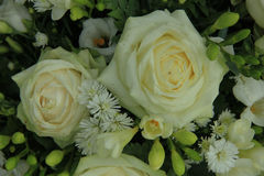 White roses in bridal bouquet. White roses, mixed with green in a bridal bouquet Royalty Free Stock Image