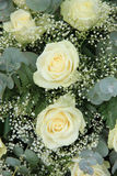 White roses in bridal bouquet. White roses, mixed with green in a bridal bouquet Royalty Free Stock Photography