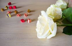 White roses and candies stock photos