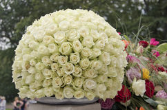 White roses centerpiece flower ball. White rose flower ball, a large outdoor festive centerpiece standing on a white fence with a colorful mix of flowers and a royalty free stock photos