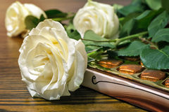 White roses and chocolates as a gift. Royalty Free Stock Photos