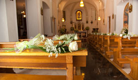 White roses in a church Royalty Free Stock Images