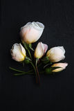 White roses on a dark surface Royalty Free Stock Images