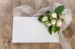 White roses with empty card for you text Royalty Free Stock Photo
