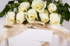 White roses, gift box and blank card for text Royalty Free Stock Images