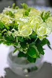 White roses in a glass vase. royalty free stock image