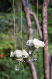 White roses in a glass vase. Hung in a wedding party Royalty Free Stock Images