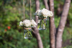 White roses in a glass vase. Hung in a wedding party royalty free stock photography