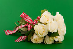 White roses on green background Royalty Free Stock Photography
