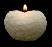 White Roses Heart Candle. White heart shaped candle with rose carved pattern Stock Photography