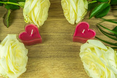 White roses with heart candles Stock Photos