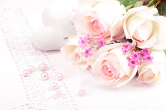 White roses and heart on tablecloth Stock Photos