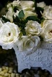 White Roses in Ornate Planter Stock Photo