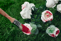 White roses and paintbrush Stock Images