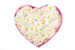 White roses and pearl and diamond held in the heart shape box Stock Image