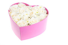 White roses and pearl and diamond held in the heart shape box Stock Photo