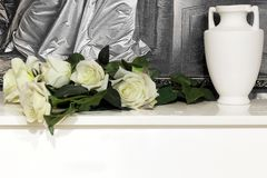 White roses on the piano.  royalty free stock image