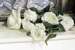 White roses on the piano stock photos