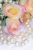 Pearls and rose heads Stock Image