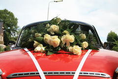 White roses on a red vintage car Royalty Free Stock Images