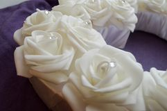 White roses with rhinestones and diamonds on a purple background. Wedding decoration from white roses Royalty Free Stock Photography