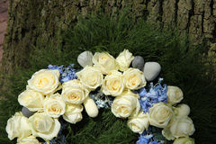 White roses on a sympathy wreath Stock Image