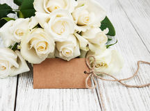 White roses with tag Stock Image